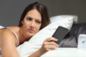Woman getting debt collection phone call in the middle of the night.