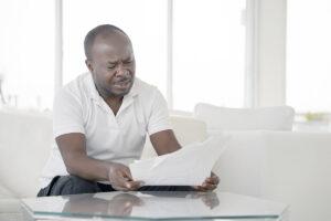 man reading errors on credit report