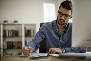 Man writing letter to credit bureau
